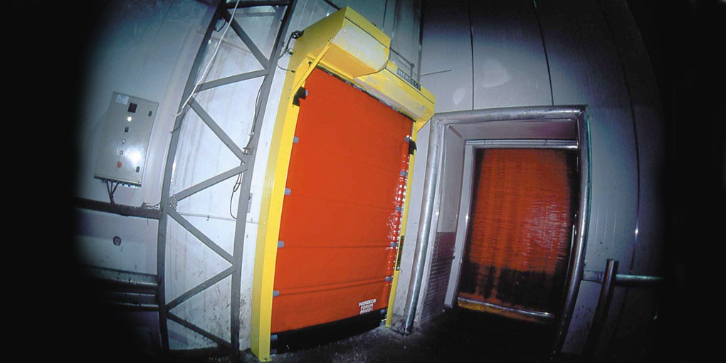 High speed freezer door with motor on the front